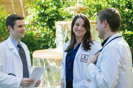Medical students standing by a fountain