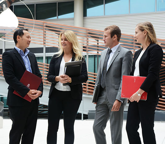 MBA students in the Moore School courtyard