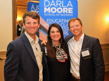 Three Moore School alumni at a regional alumni networking event