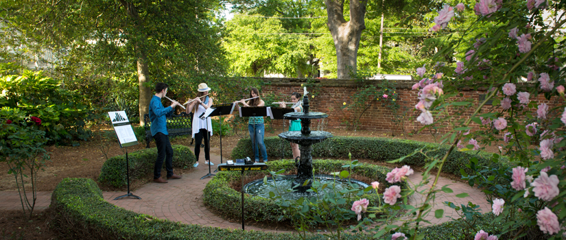 Flute students play in rose garden