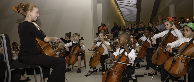 Suzuki cello students with teacher