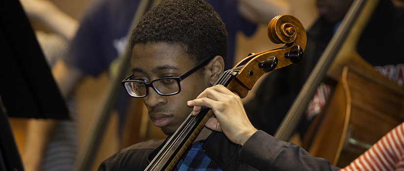 Double bass student in orchestra