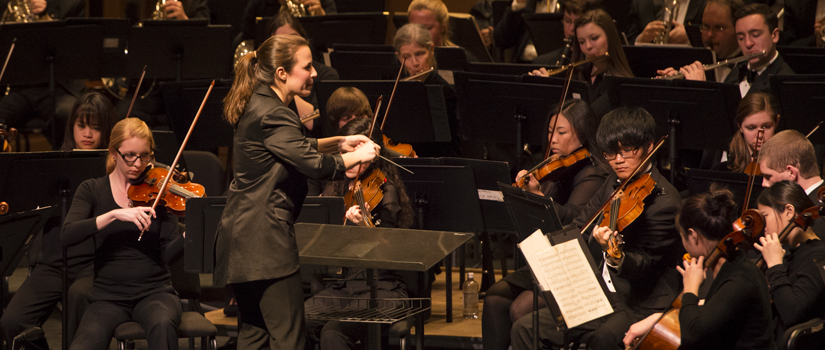 Student conducting USC Symphony Orchestra