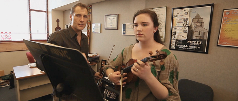 Professor Terwilliger and student of violin