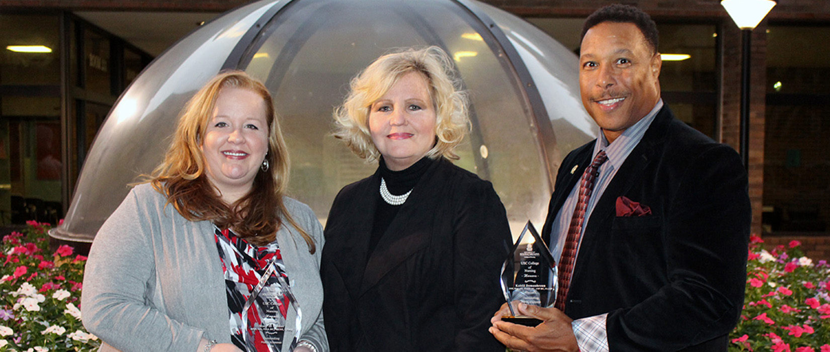 2016 Alumni Award Recipients Stacy Collier and Kahlil Demonbreun with Dean Jeannette Andrews.