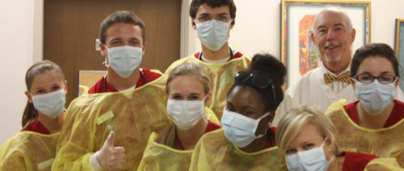 Students in protective gowns
