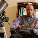 Professor teaches with a telescope