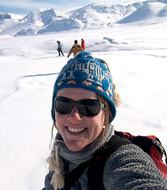 Lori Ziolkowski selfie with icy Antarctica backdrop.