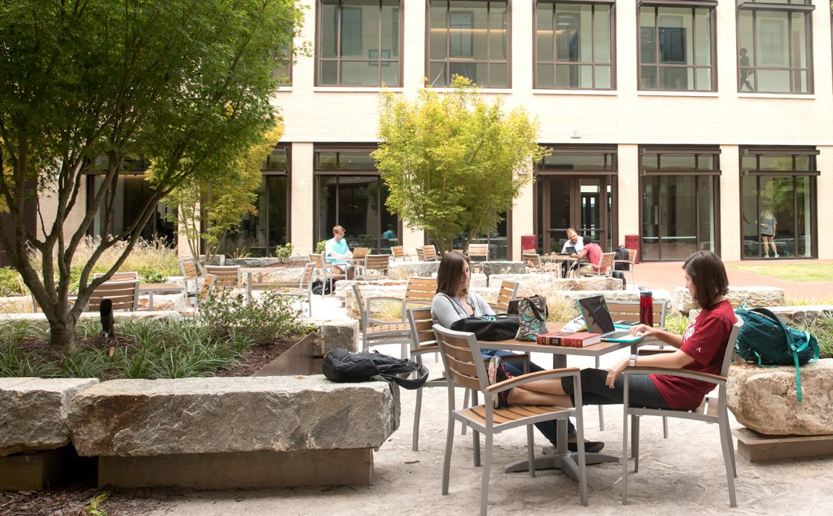 Students studying in the courtyard of the Law School