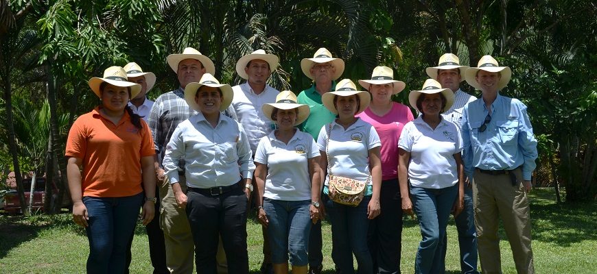 Kubickova and Campbell with Honduran farmers