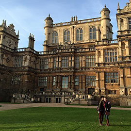 Photo of Meghan Conroy and a fellow Master's student at Wollaton Hall in Nottingham