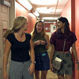 students talking in a hallway