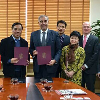 President Harris Pastides, Dean Haemoon Oh, Huong Nguyen and Kendall Roth in Vietnam