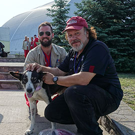 Tim Mousseau and a stray dog at Chernobyl