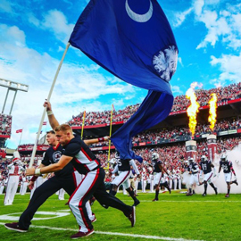 Football team is led in with the South Carolina state flag