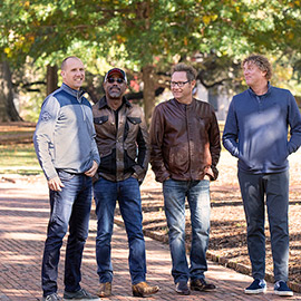 4 members of the Hootie & the Blowfish standing on the Horseshoe