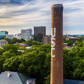 The USC smokestack rises above the skyline of Columbia