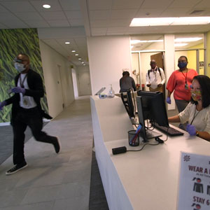 students walk in building on campus
