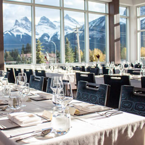 empty dining room with the alps in the background