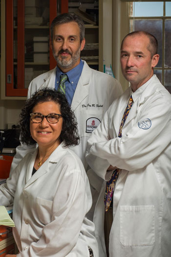 Claudia Grillo and her research colleagues, Jim Fadel, left, and Larry Reagan
