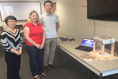 Jun Zhou, Karen Smith and Yuhang Lu work with 3D scanner and pottery