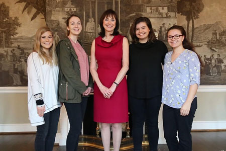journalism students with First Lady Patricia Moore-Pastides