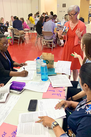 Dr. Long works with teachers at Jackson Creek school
