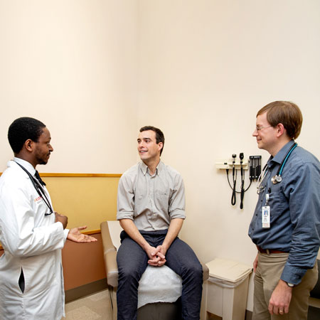 Drs. Patterson and Shaffer with a patient