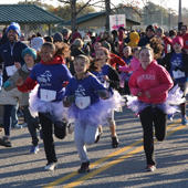 girls running in a Girls on the Run race