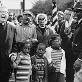 Civil rights leader Ralph David Abernathy, Juanita Abernathy, Martin Luther King Jr., Coretta Scott King and Abernathy's children leading the famous Selma to Montgomery march in 1965.