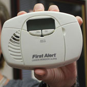 Amber Williams with carbon monoxide detector